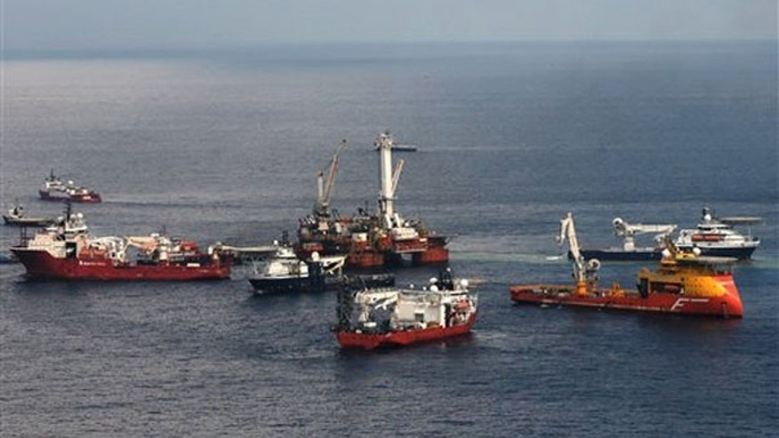 In this May 26 photo provided by the U.S. Coast Guard, a mobile offshore drilling unit holds position over the damaged Deepwater Horizon blowout preventer as crews work to plug the wellhead. (AP Photo)
