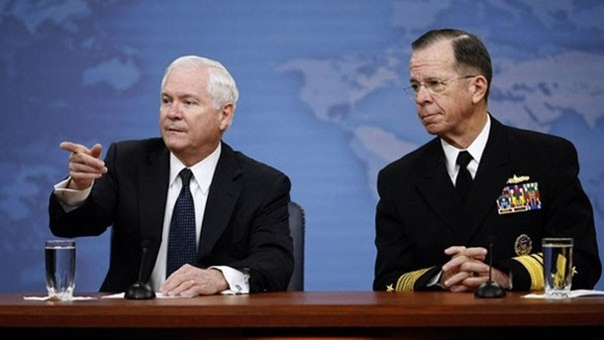 Mar. 25: Defense Secretary Robert Gates and Chairman of the Joint Chiefs of Staff Adm. Mike Mullen take questions on 'Don't Ask, Don't Tell' at a media briefing in Washington.
