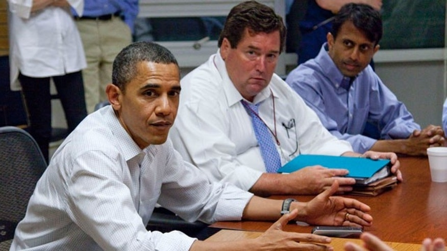 May 28: Obama, accompanied by Plaquemines Parish President Billy Nungesser,and Louisiana Gov. Bobby Jindal, gets a briefing on the oil spill at the U.S. Coast Guard Station in Grand Isle, La. (AP)