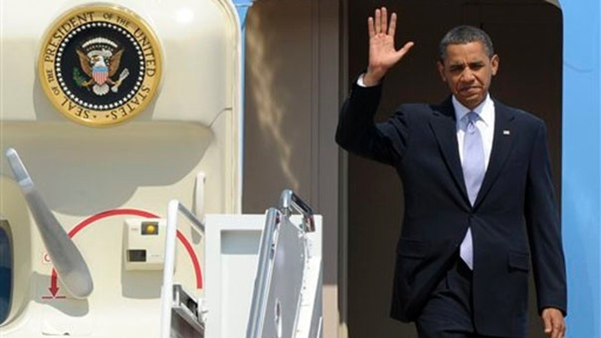 President Obama waves as he walks off Air Force One at Andrews Air Force Base June 2, after a trip to Pittsburgh. (AP Photo)