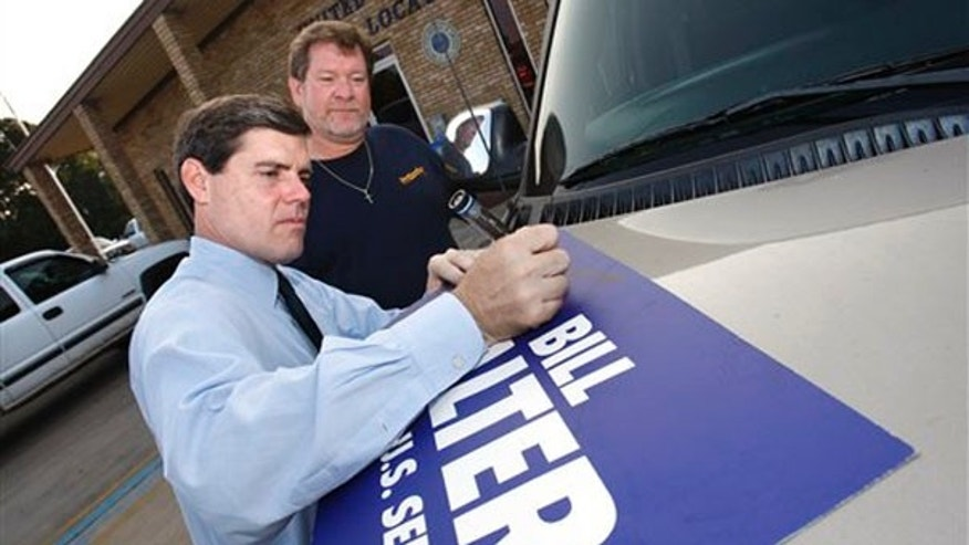 Monday: Democratic Lt. Gov. Bill Halter, who is running for Senate in Arkansas, signs a placard for David Beard, a worker with the United Steel Workers Union Local 752L, in Texarkana, Ark. (AP Photo)