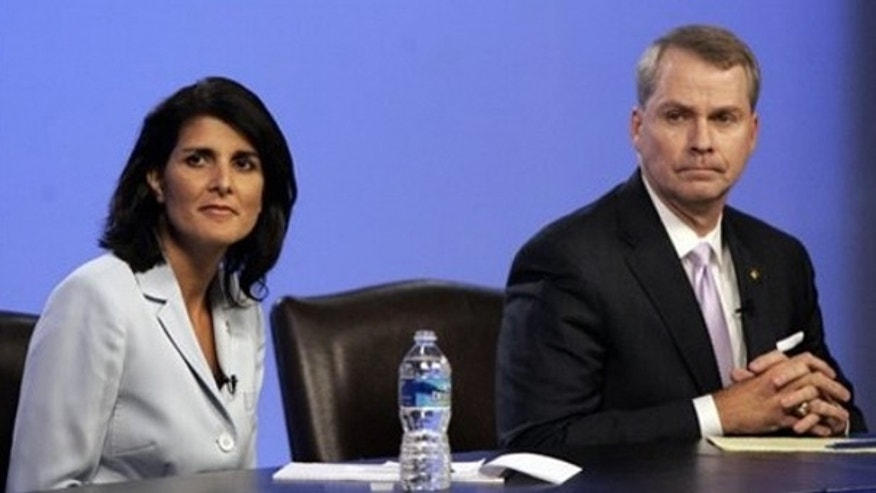 South Carolina state Rep. Nikki Haley, left, and U.S. Rep. Gresham Barrett are asked questions during a GOP gubernatorial debate in Columbia, S.C., June 17. (AP Photo)