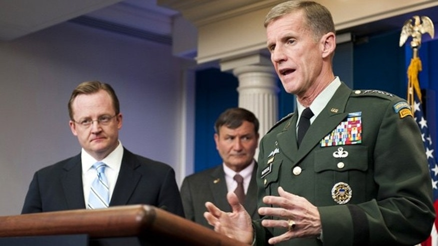 May 10: General Stanley McChrystal speaks during a press briefing with White House spokesman Robert Gibbs, left, and U.S. Ambassador to Afghanistan Karl Eikenberry at the White House.