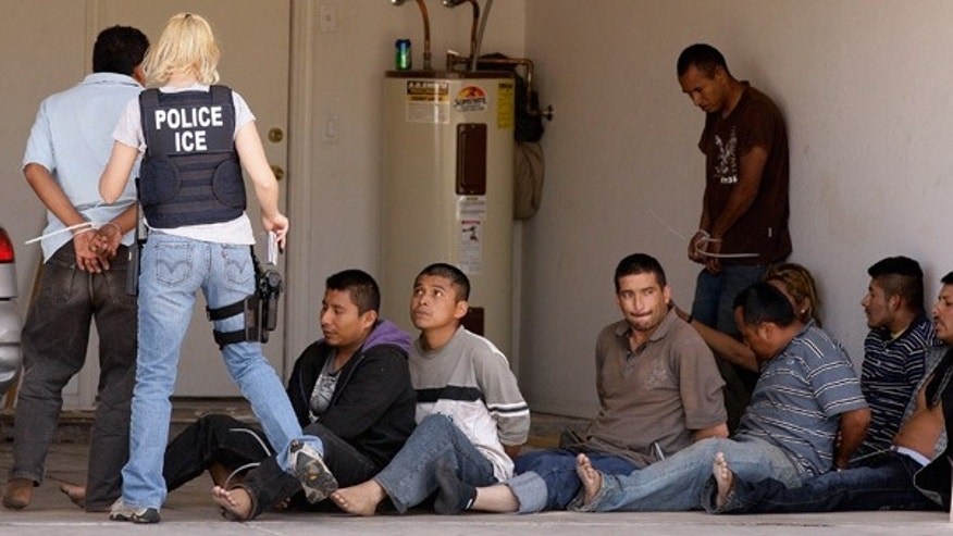FILE: Agents raid a drop house for illegal immigrants in Phoenix in April.