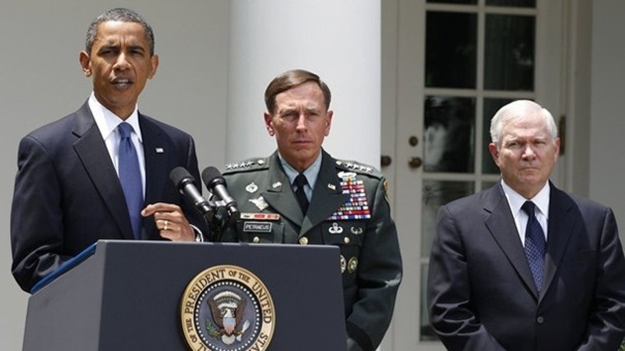 June 23: President Obama announces Gen. David Petraeus, center, will replace Gen. Stanley McChrystal in Afghanistan as Secretary of Defense Robert Gates listens.