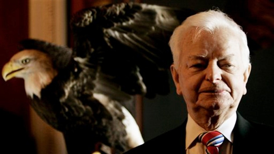 "April 12, 2007: Sen. Robert Byrd, D-W.Va., is pictured with American bald eagle ""Challenger"" on Capitol Hill in Washington, during the announcement of a resolution for American Eagle Day."