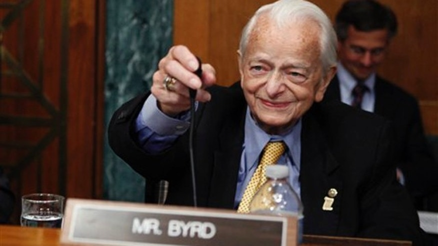 May 20, 2010: Sen. Robert Byrd, D-W.Va., readies his microphone as he arrives to question panel members on Capitol Hill in Washington, during the Senate Health and Human Services subcommittee hearing on mine safety.