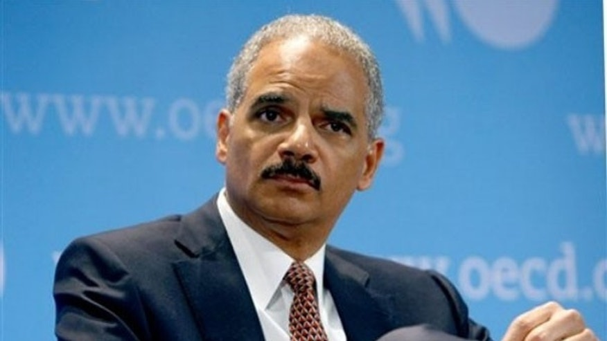Attorney General Eric Holder is seen at the Organization for Economic Co-operation and Development during a meeting May 31 in Paris. (AP Photo)