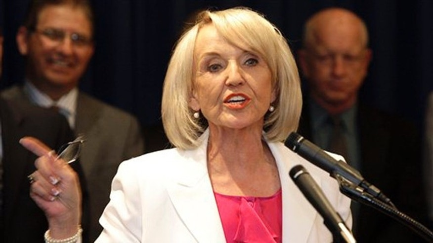Arizona Gov. Jan Brewer speaks at the state capitol Tuesday in Phoenix. (AP Photo)