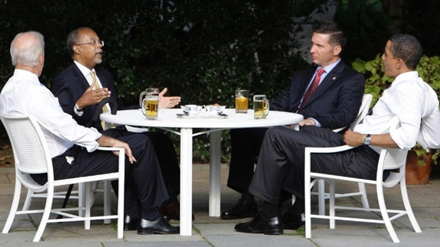 In this July 30, 2009 file photo, President Obama, right, and Vice President Biden, left, have a beer with Harvard scholar Henry Louis Gates Jr., second from left, and Cambridge, Mass., police Sgt. James Crowley in the Rose Garden of the White House in Washington.