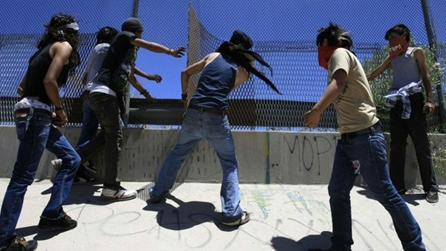 June 12: Mexicans are seen damaging the U.S. border fence, during a protest on the outskirts of Ciudad Juarez.