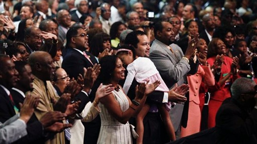 The audience applauds after first lady Michelle Obama speaks at the annual NAACP convention July 12 in Kansas City, Mo. (AP Photo)