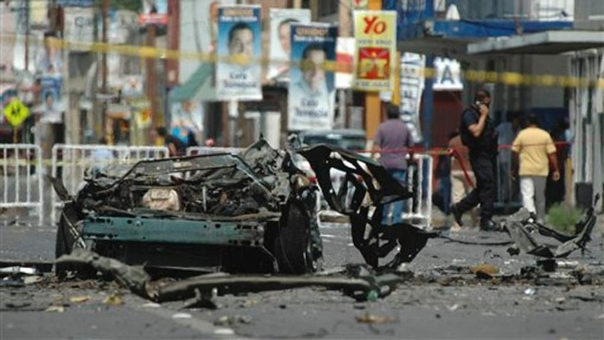 The remains of a vehicle are seen on a street in the northern border city of Ciudad Juarez, Mexico, July 16, 2010. (AP Photo)