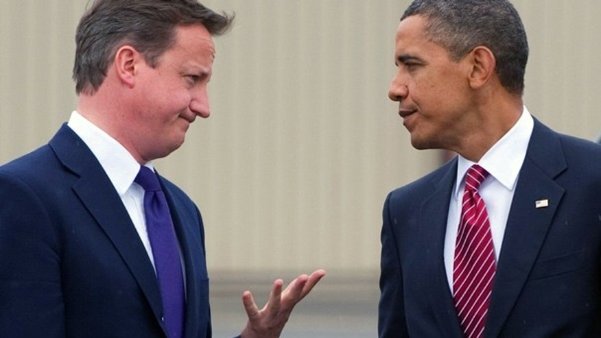 June 26: President Obama and British Prime Minister Cameron talk at the conclusion of the G20 conference in Ontario, Canada.