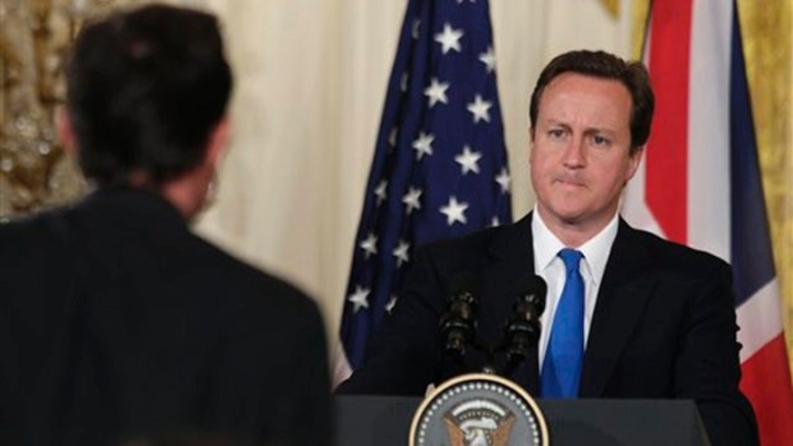 British Prime Minister David Cameron is seen at a news conference with President Obama, not shown, in the East Room of the White House July 20. (AP Photo)
