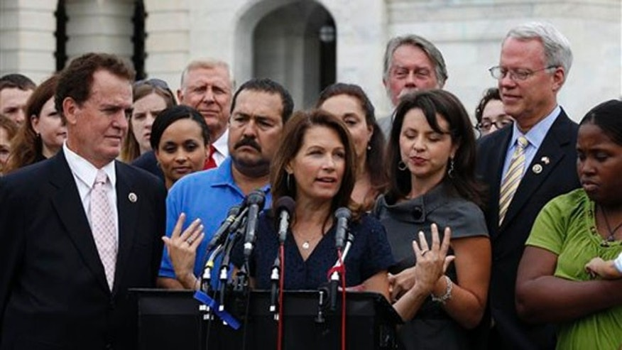 Rep. Michele Bachmann, center, speaks at a press conference for the Tea Party Caucus July 21 in Washington, D.C. (AP Photo)