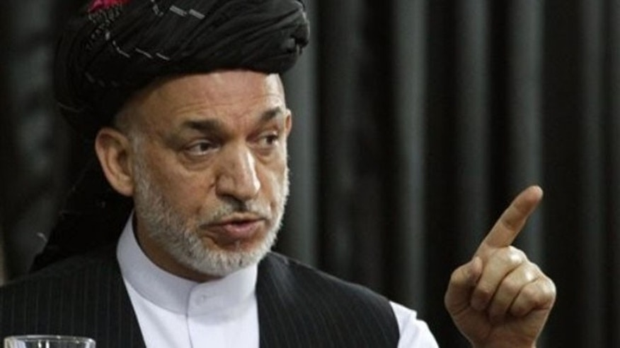 June 13: Afghan President Hamid Karzai speaks during a gathering in Kandahar, south of Kabul, Afghanistan (AP).