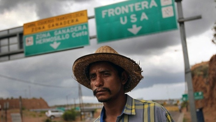July 27: Mexican immigrant Luis Manuel, 29, walks along the U.S.- Mexico border after being deported from Arizona.