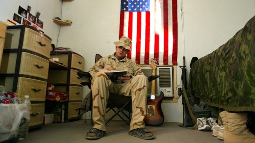 Oct. 6, 2004: U.S. Army Sgt. George Scheufele fills out an absentee ballot while voting in the American presidential and congressional election while at Camp Eagle in the violent Sadr City neighborhood of Baghdad, Iraq, , ahead of the Nov. 2 polls in the United States.