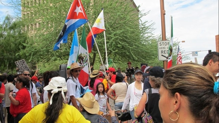The daylong demonstrations across downtown Phoenix came despite a federal judge's last-minute decision to block the most controversial parts of the measure.