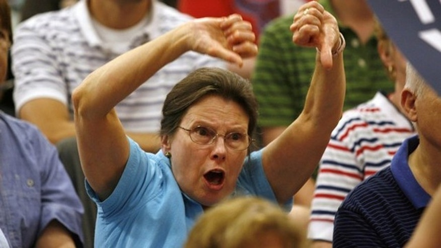 A constituent gestures at a town hall meeting on health care reform at the South Lakes High School gymnasium in Reston, Virginia, August 25, 2009. (Reuters)