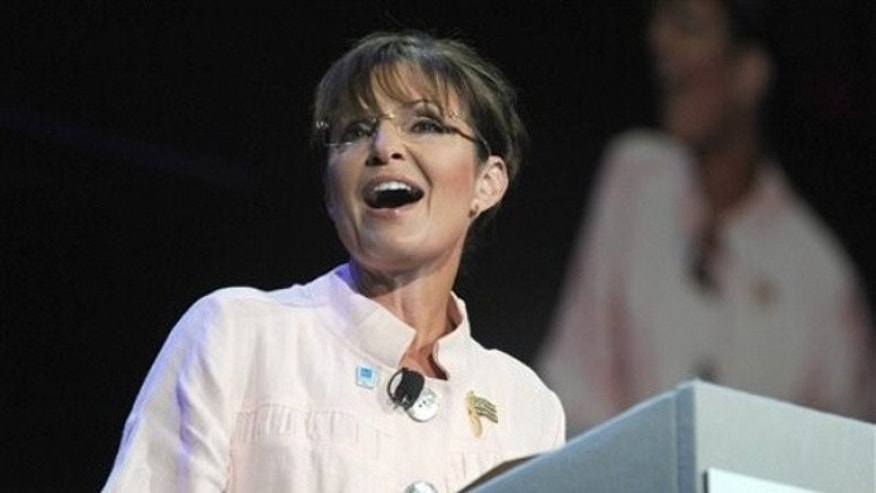 Former Alaska Gov. Sarah Palin speaks to the crowd at a P.U.R.E. Ministries event June 29 in Duluth, Ga. (AP Photo)