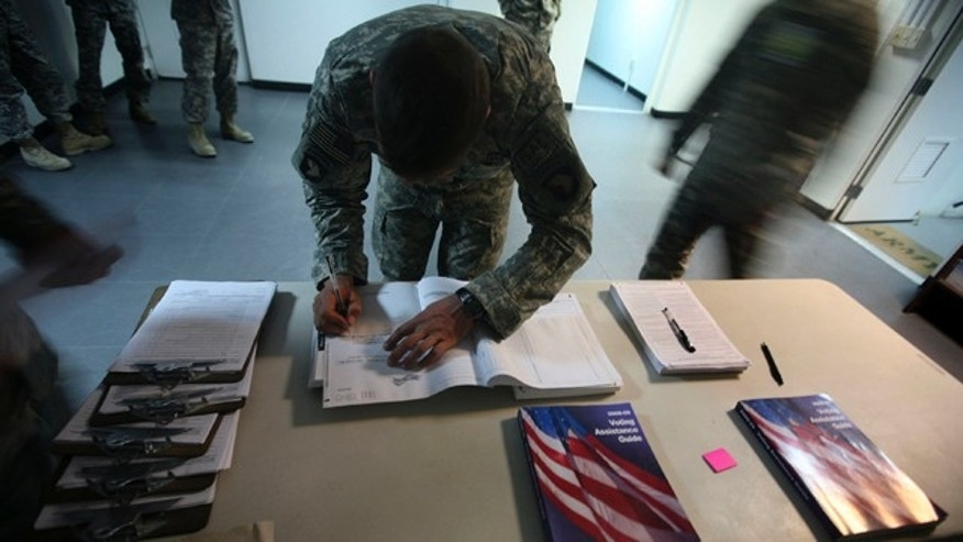 Oct. 15, 2008: A U.S member of Combained Joint Task Force-101 filling out voter absentee ballot at a US military base in Bagram north of Kabul, Afghanistan.