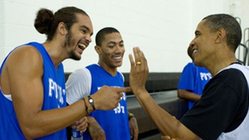 Aug. 8: President Obama talks with Joakim Noah (left) and Derrick Rose of the Chicago Bulls.