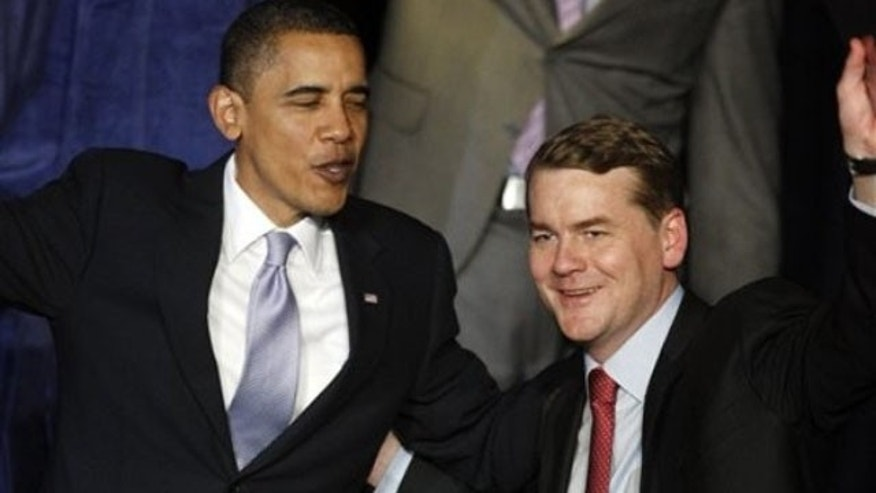 President Barack Obama jokes with Sen. Michael Bennet, D-Colo. , after a fundraising event in Denver, on Thursday, Feb. 18, 2010 (AP).