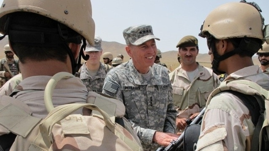 Gen. David Petraeus, Commander US/NATO Forces Afghanistan, greets Ministry of Interior Special Forces after a military exercise.