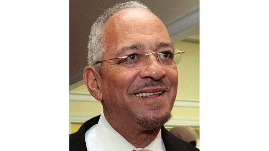 In a March 5, 2009 file photo, the Rev. Jeremiah Wright leaves the Selma Performing Arts Center, in Selma, Ala.
