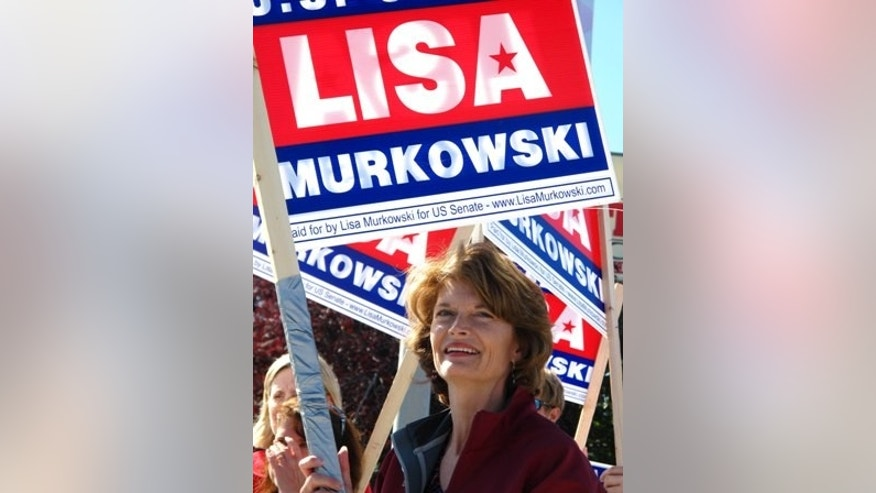 "U.S. Sen. Lisa Murkowski, R-Alaska, right, joins volunteers to wave to motorists on Monday, Aug. 23, 2010, in Anchorage, Alaska.  Candidates are pulling no punches in their last minute push for voters in Tuesday's primary. The greatest proof of this is in the U.S. Senate race where Sarah Palin has re emerged months after first endorsing GOP challenger Joe Miller to urge Alaskans to support him and to oust Murkowski. Murkowski's not shying away, running a new radio spot of her own, called ""Truth,"" in which she uses audio from a talk show host's tirade against Miller to show Miller as distorting her record. (AP Photo/Mark Thiessen)"