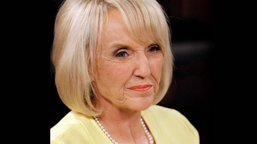 Sept. 1, 2010: Republican Arizona Gov. Jan Brewer waits for a TV debate to begin.