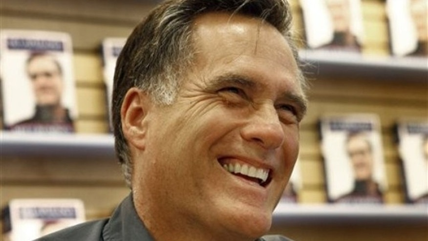 "Former Republican presidential candidate and Massachusetts Gov. Mitt Romney smiles at a book signing for his book ""No Apology: The Case for American Greatness"" at a Barnes and Noble, Wednesday, April 7, 2010, in Manchester, N.H. (AP)"