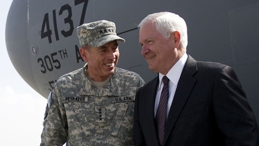 Sept. 2: Defense Secretary Robert Gates, right, is greeted by top NATO commander Gen. David Petraeus as he arrives in Kabul.