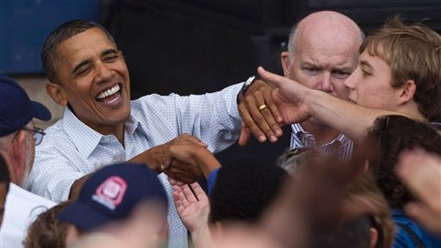 President Obama shakes hands after speaking at the annual Milwaukee Area Labor Council Laborfest Sept. 6 in Milwaukee. (AP Photo)