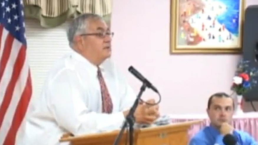 Rep. Barney Frank is shown taking a question in August 2009 at a town hall meeting in Dartmouth, Mass. (YouTube)