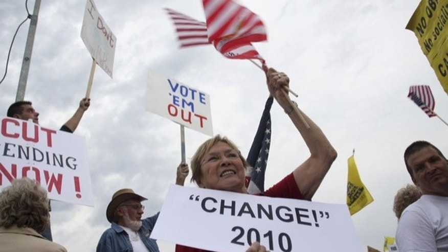 Aug. 17: Tea Party protesters in Arizona hold signs demanding Congess cut spending.