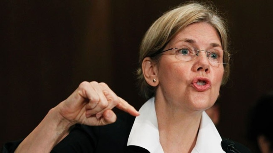 FILE: July 21, 2011: Elizabeth Warren, as head of the Congressional Oversight Panel, testifies before a Senate Finance Committee.