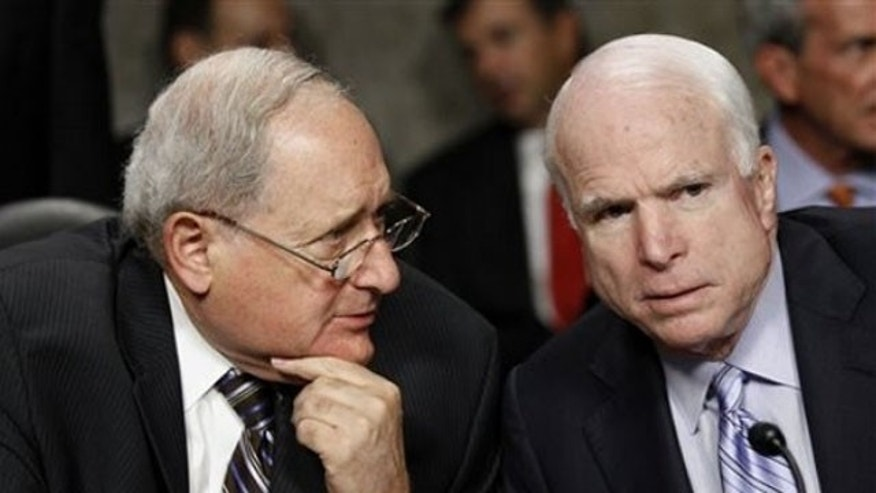 Senate Armed Services Committee Chairman Sen. Carl Levin, left, talks with the committee's ranking Republican Sen. John McCain on Capitol Hill Aug. 3. (AP Photo)