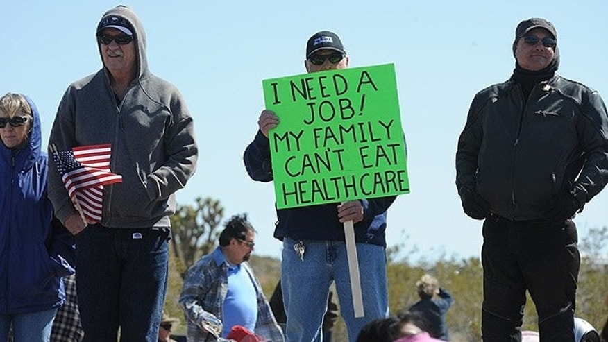 March 27: Tea Party supporters hold signs during a rally in Searchlight, Nevada.