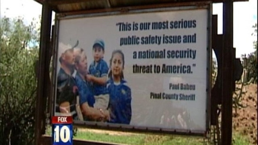 A billboard of an El Salvadoran family next to a quote by Paul Babeu has infuriated the Pinal County, Ariz., sheriff, who says it slanders him.