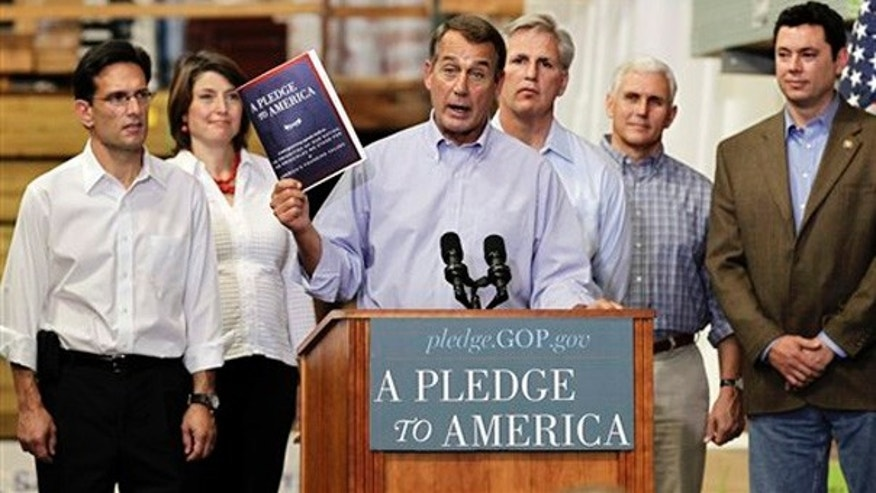 "Thursday: House Minority Leader John Boehner of Ohio, center, holds up a copy of the GOP agenda, ""A Pledge to America."" Rep. Kevin McCarthy, R-Calif., who appeared with Boehner on ""Fox News Sunday,"" stands behind Boehner's left shoulder."