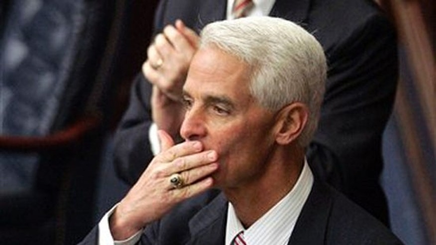 Gov. Charlie Crist throws a kiss to the crowd after finishing his last state of the state speech on Tuesday, March 2, 2010. (AP)