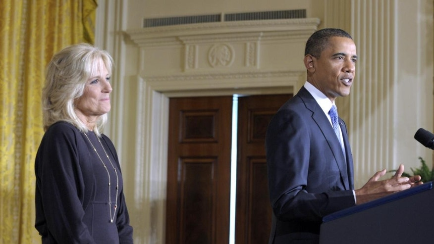 President Barack Obama speaks at the Community College Summit as Dr. Jill Biden, left, listens in the East Room of the White House in Washington, Tuesday, Oct. 5, 2010. (AP Photo/Susan Walsh)