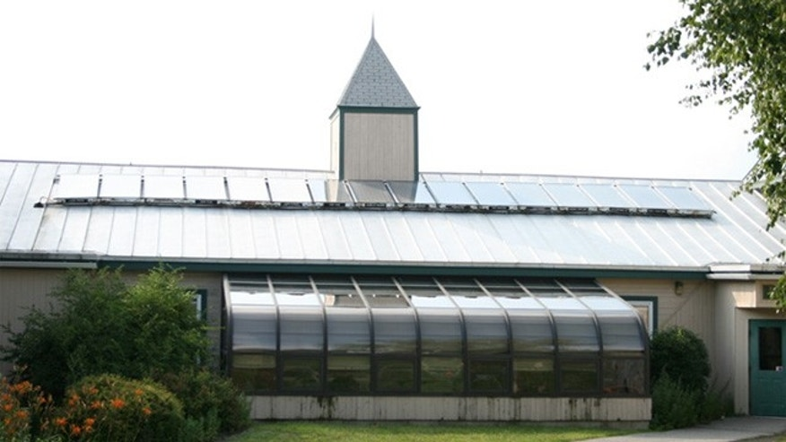 Solar panels that used to power the White House are shown on top of a building at Unity College in Maine. (Courtesy of 350.org)