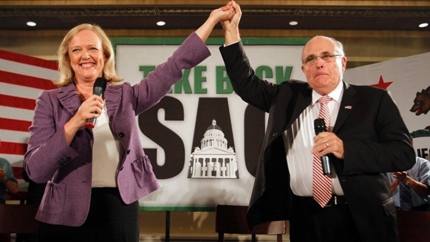 Oct. 10: California Republican gubernatorial candidate Meg Whitman, left, with former New York City mayor and 2008 presidential candidate Rudy Giuliani speak during a campaign stop at Airtel Plaza Hotel in Van Nuys, Calif.
