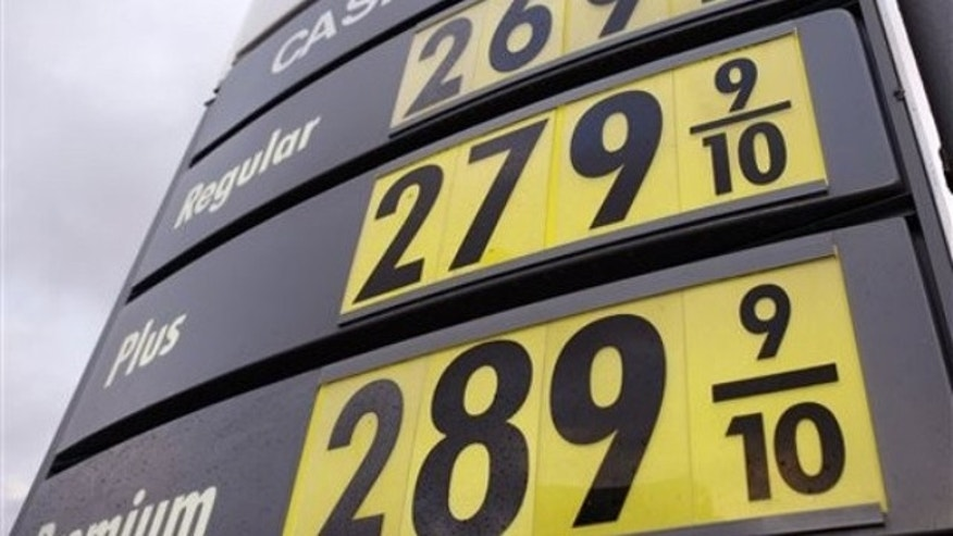 In this Dec. 28, 2009, photo, gasoline prices are posted at a Shell service station in Boston. (AP Photo)