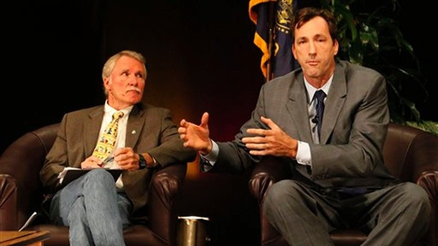 Oregon gubernatorial candidate John Kitzhaber, left, listens as fellow candidate Chris Dudley, right, talks at a joint candidate forum Sept. 25 in Eugene, Ore. (AP Photo)