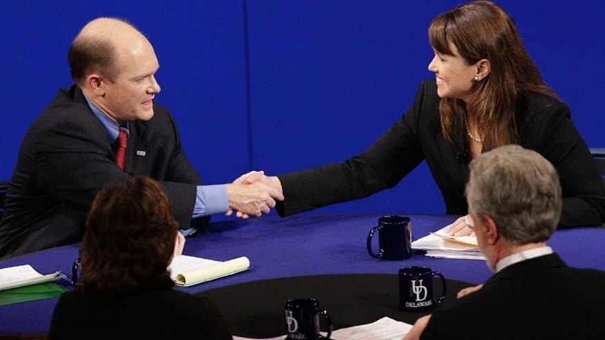 Oct. 13: Democratic candidate Chris Coons and Republican candidate Christine O'Donnell shake hands after a televised Delaware Senate debate at the University of Delaware in Newark, Del.